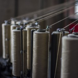 Tying in one of our Braiding Machines for Natural Stone Coloured Worsted Braided Ties