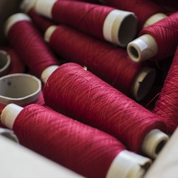 Maroon Yarn Being Prepared for the Weaving Process